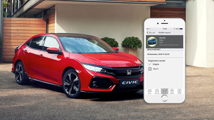 Front facing shot of Civic with phone and health monitor app